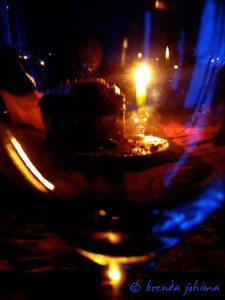 iPhone Photograph of wine glass and chocolate cake by brenda johima